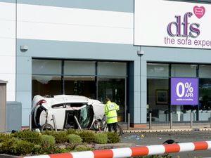 The scene at DFS in Cannock, after a car crashed into the store in May 2019