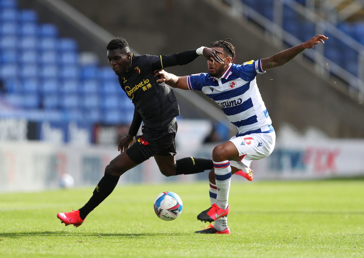 Watford's Ismaila Sarr (left) and Reading's Liam Moore