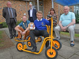 Alexander Soloman, a pupil at Bilston C of E School, has raised £402 in the Rotary club bike-a-thon for Green Park School, Bilston. Supporting him are, from left: Gary Gentle, Ken Dolman, Lorraine Dawney and Councillor Phil Page