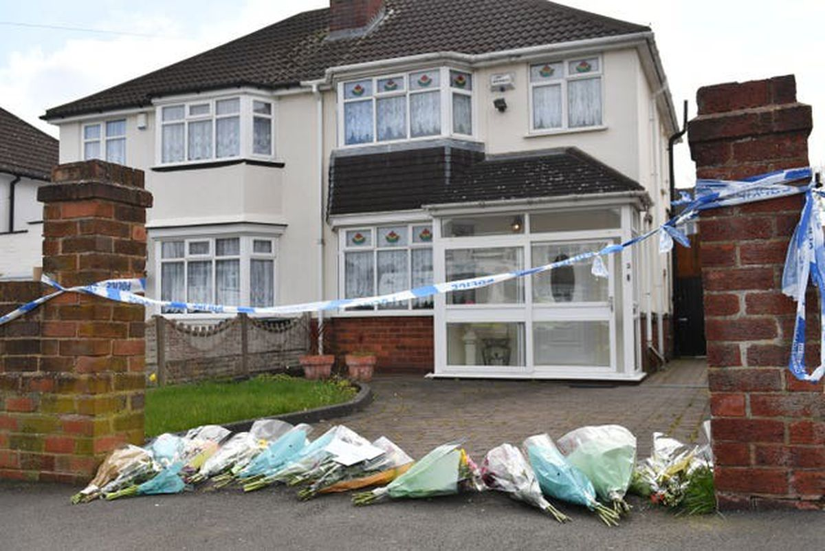 Flowers outside the house on Boundary Avenue in Rowley Regis (Jacob King/PA)