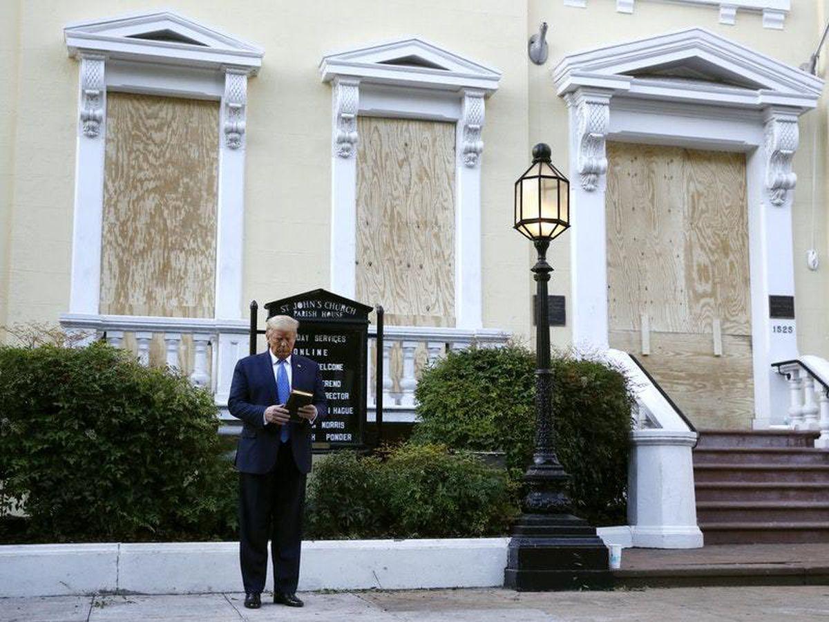 President Donald Trump holds a bible outside St John's Church in Washington DC