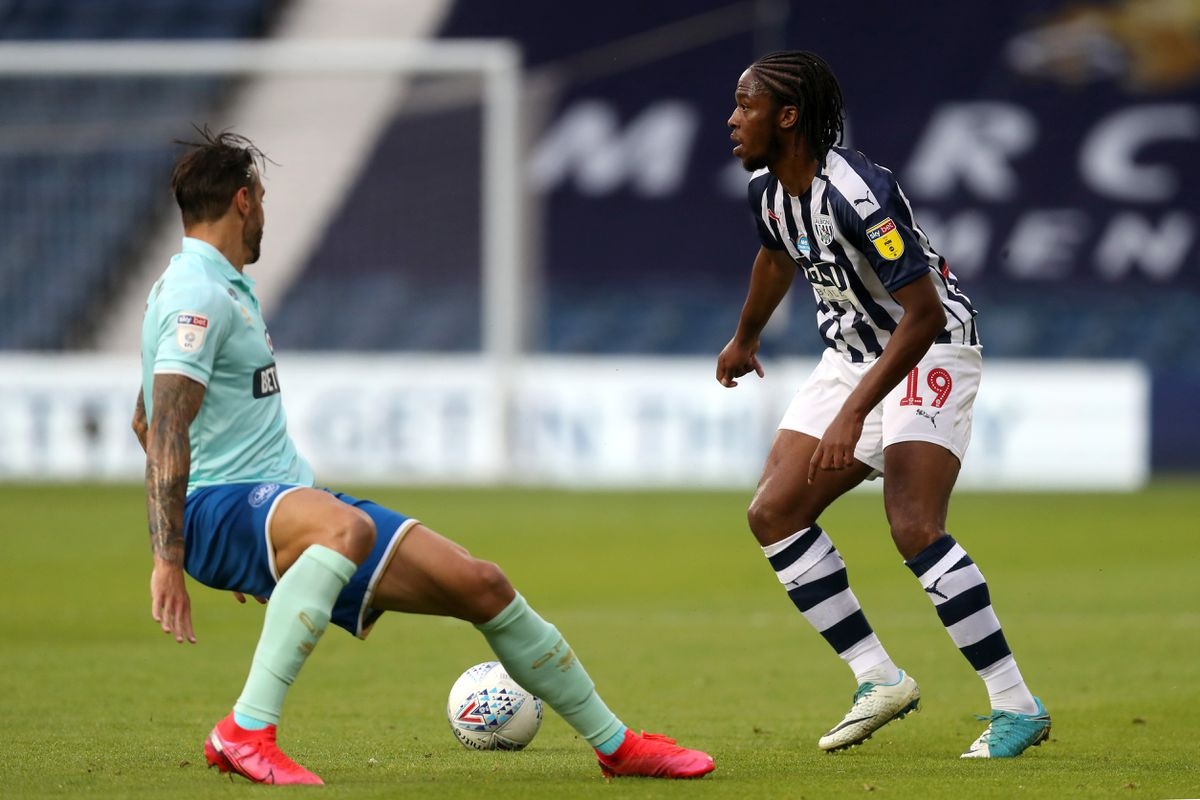 Geoff Cameron of Queens Park Rangers and Romaine Sawyers of West Bromwich Albion. (AMA)