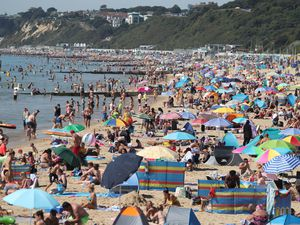 People enjoying the hot weather on Bournemouth beach in Dorset