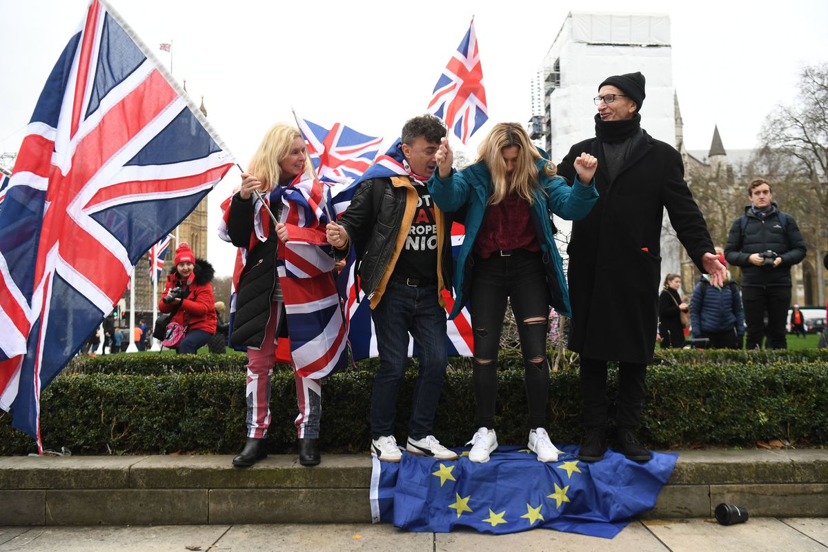 Brexiteers stand on the EU Flag, ahead of the UK leaving the European Union