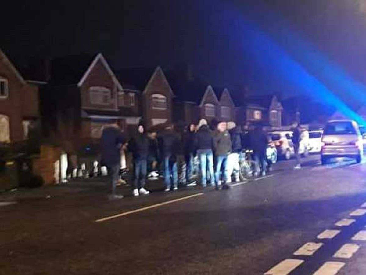 The gathering in Walker Road, Blakenall. Photo: Liam Walsall