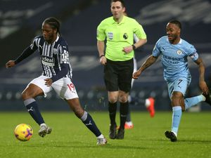 Romaine Sawyers of West Bromwich Albion and Raheem Sterling of Manchester City.