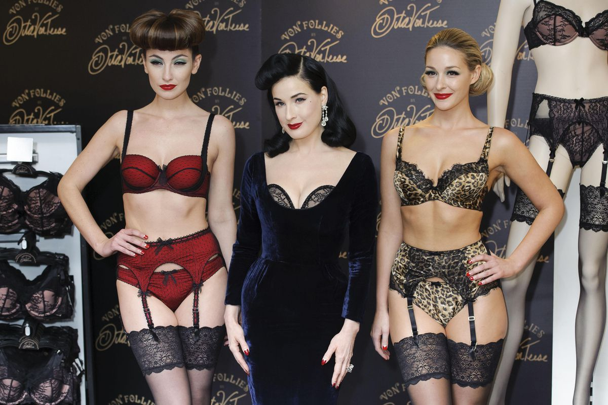 Dita Von Teese poses with models to launch her new lingerie line Von Follies in 2012
