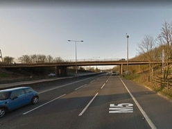Police catch man after he jumps from bridge over M5