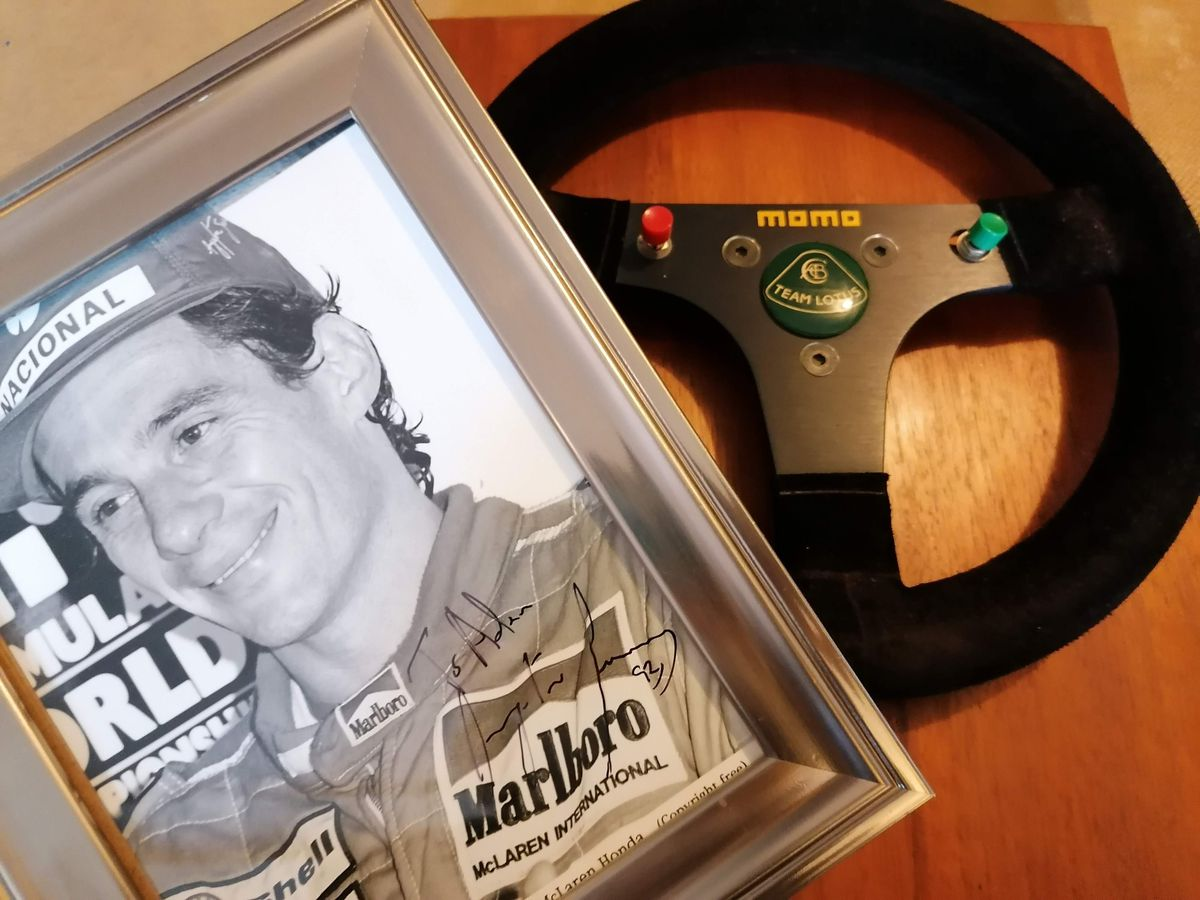 The steering wheel and signed photo of Ayrton Senna. Photo: Hansons