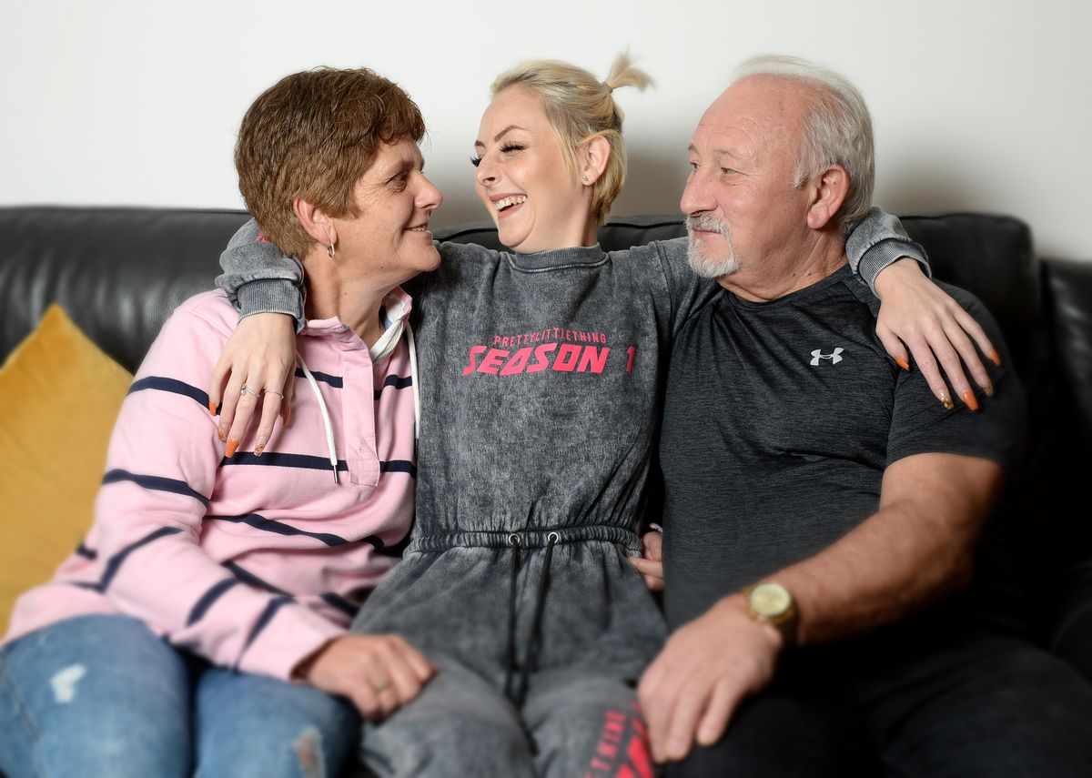 Megan is pictured with mum Shirley and dad Pete