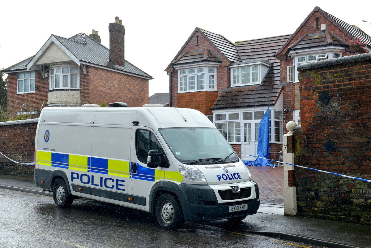 Police outside the family home in Penn in the aftermath of the alleged murder