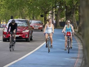 People riding bicycles in a cycle lane in Chelsea