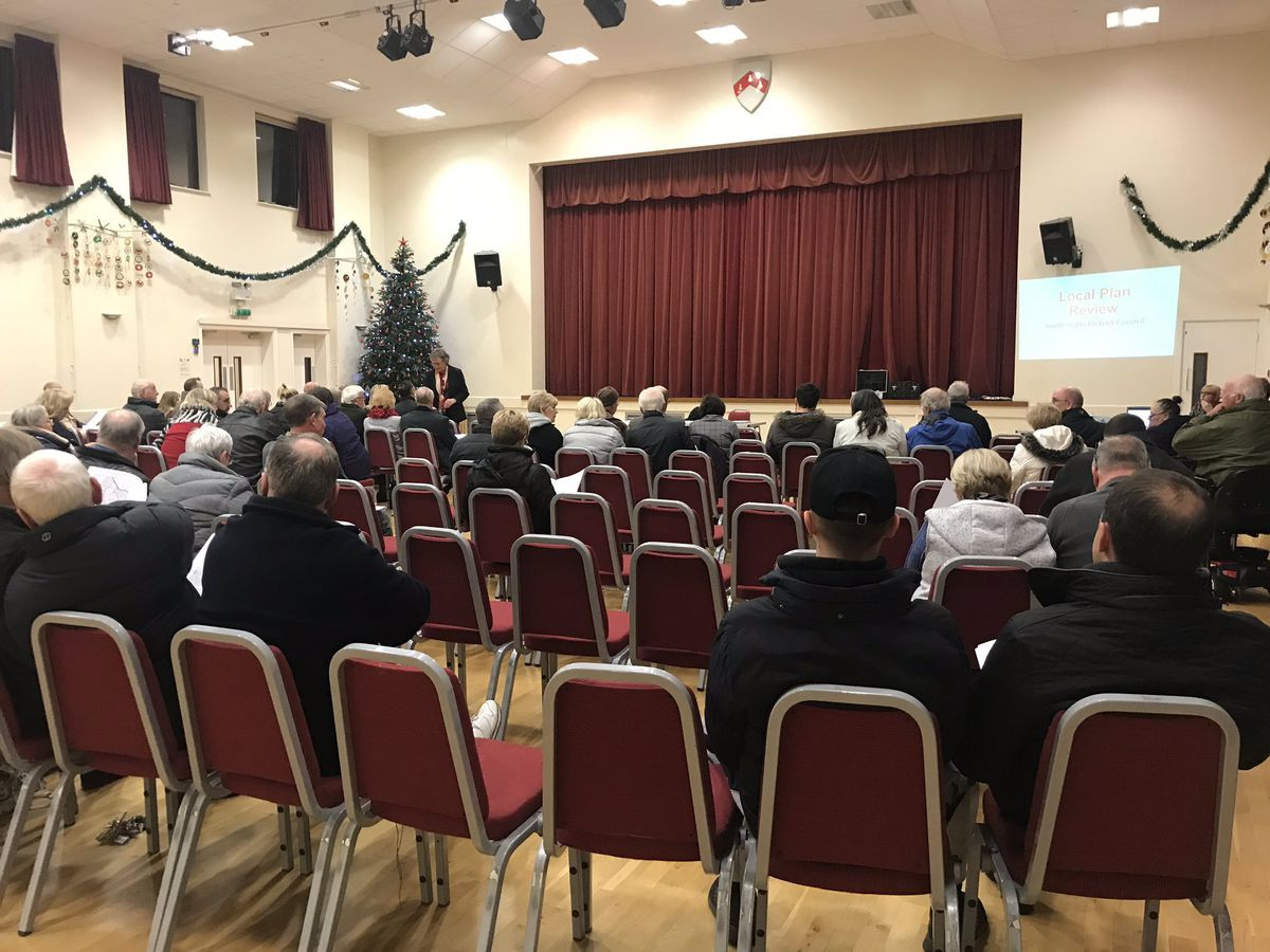Residents turn out to voice concerns over proposals to build almost 600 homes on green belt land.
