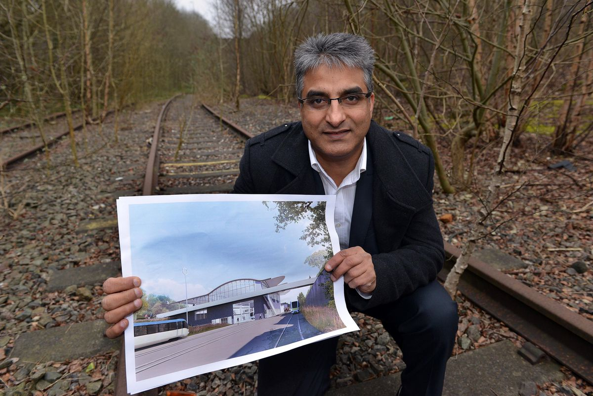 Former council regeneration boss Khurshid Ahmed shows off the plans for the Very Light Rail centre