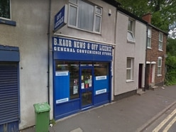Arrests after shop worker pushed to ground in robbery