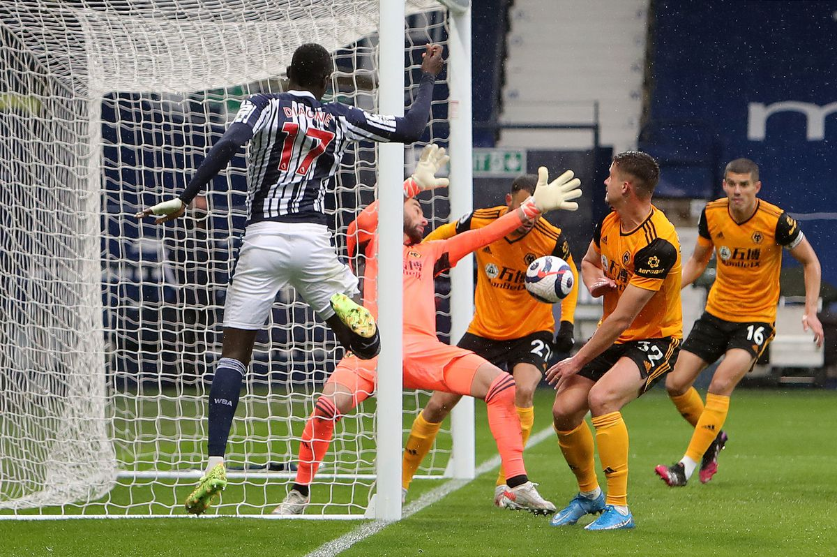 """West Bromwich Albion's Mbaye Diagne sees his shot saved by Wolverhampton Wanderers goalkeeper Rui Patricio during the Premier League match at The Hawthorns, West Bromwich. Issue date: Monday May 3, 2021. PA Photo. See PA story SOCCER West Brom. Photo credit should read: Geoff Caddick/PA Wire. ..RESTRICTIONS: EDITORIAL USE ONLY No use with unauthorised audio, video, data, fixture lists, club/league logos or """"live"""" services. Online in-match use limited to 120 images, no video emulation. No use in betting, games or single club/league/player publications.."""