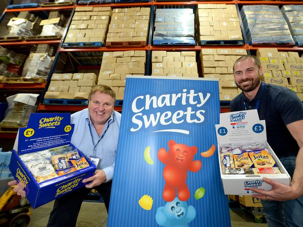 Bob Strong and son Stuart demonstrate some of the wares on offer at Sweet Causes