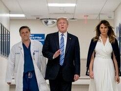 Donald Trump meets school shooting victims during visit to Florida hospital
