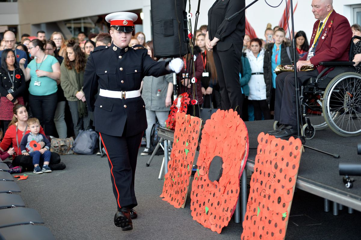 A wreath is laid at the Remembrance Day ceremony at Walsall College