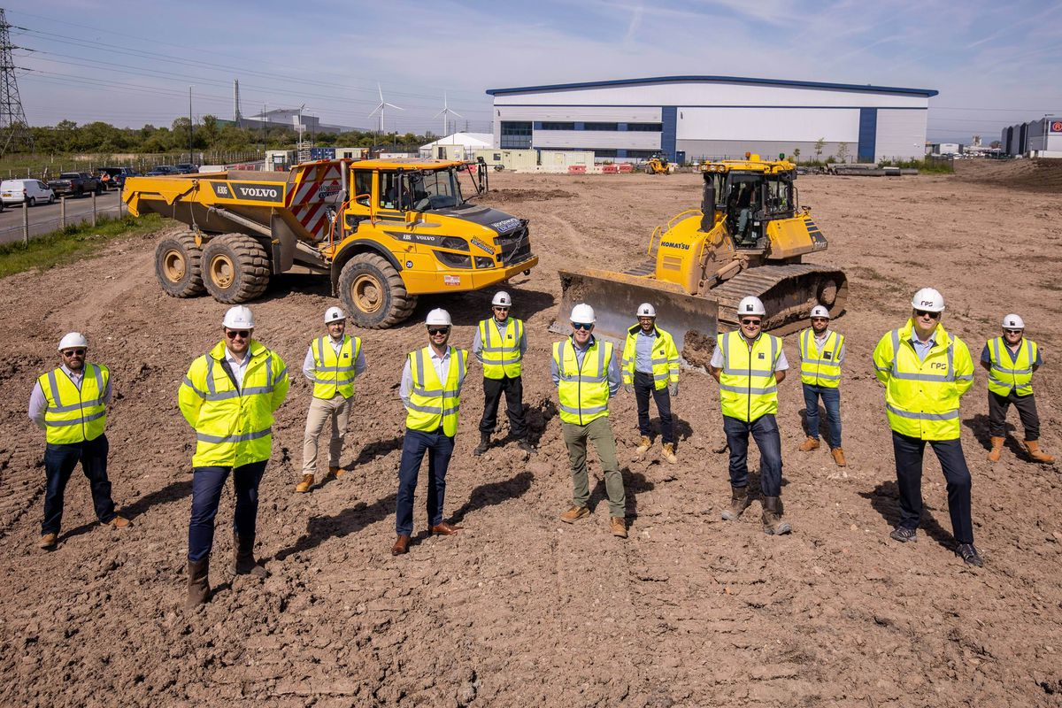 Jon Robinson, Henry Bellfield and Jon Mott (all of Barberry), Paul Burt (ISG) and Stuart Dean (RPS), are joined by members of the project team at the Richardson Barberry More+ Central Park development in Avonmouth