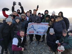 Staff scale the heights to raise money to support young Harrison
