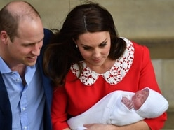 Baby prince of Cambridge makes his debut with William and Kate
