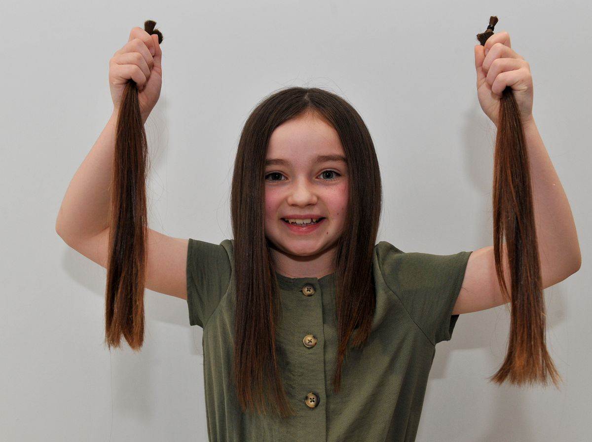 Mia Livesey, aged eight, had 12 inches of her hair cut off before donating it to the Little Princess Trust