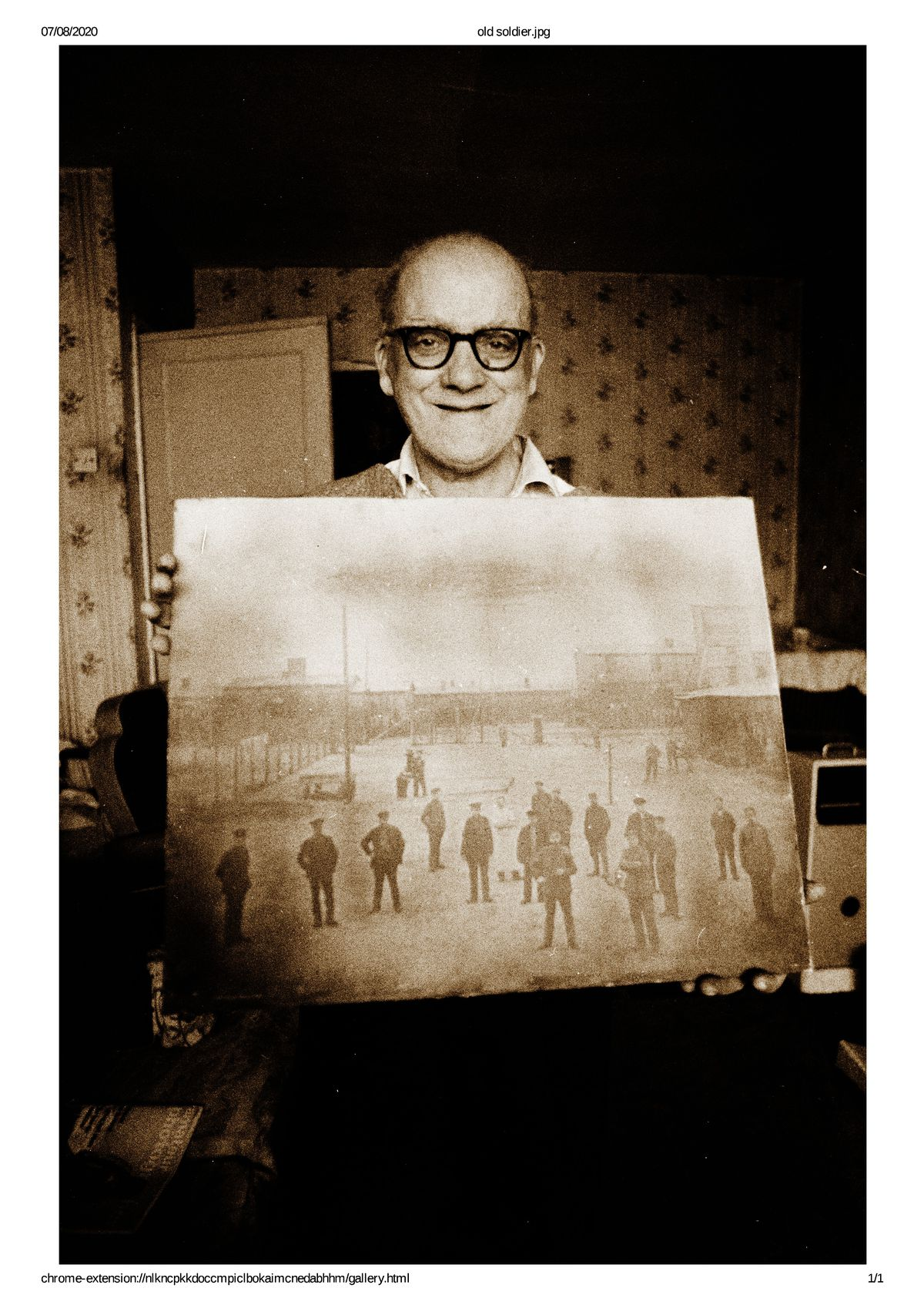 Joanne's great uncle Joseph with a picture of his former regiment
