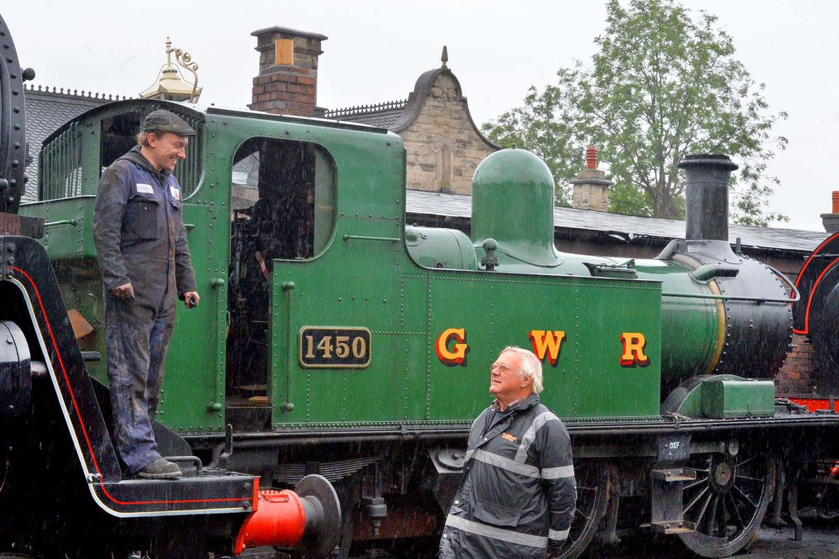 Station master Chris Thomas chats to fitter Steve Llewellyn