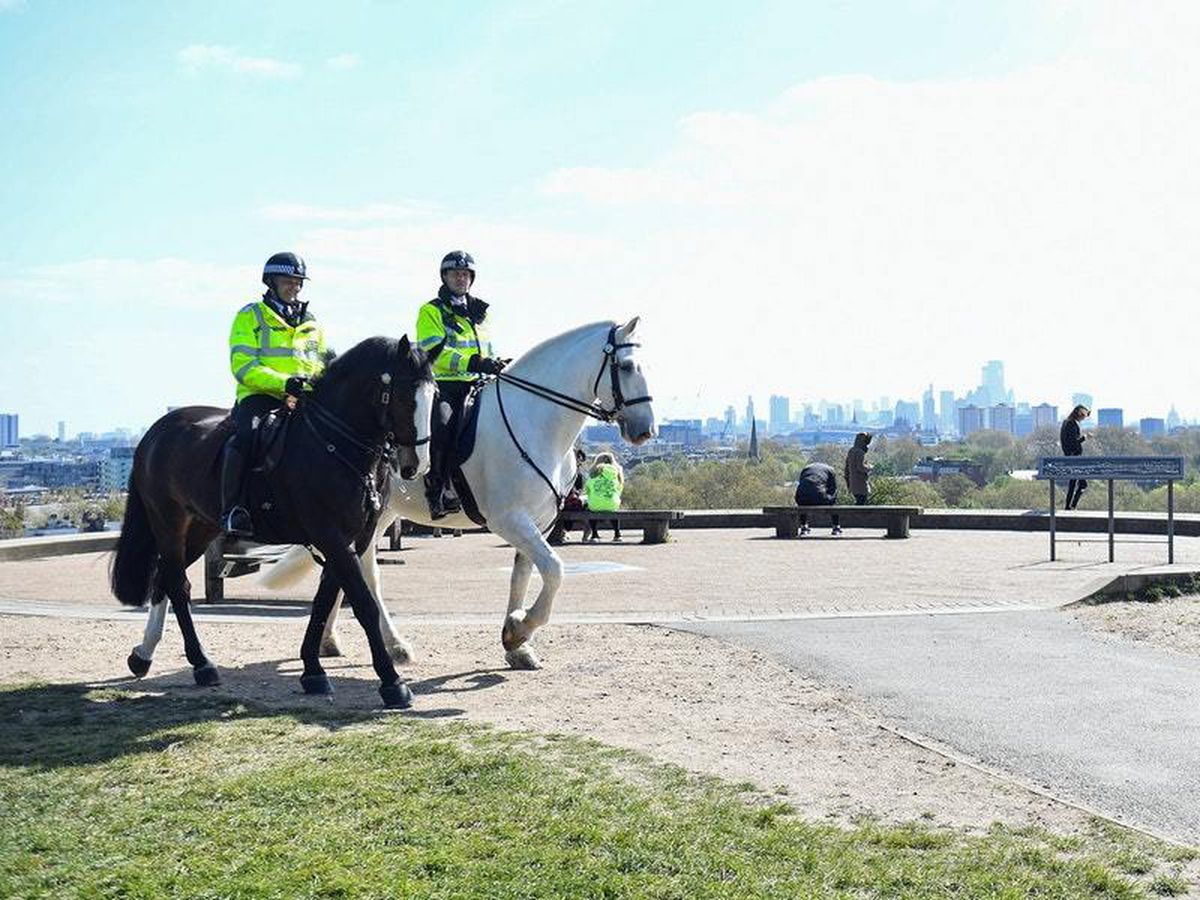 Mounted police officers on Primrose Hill in London