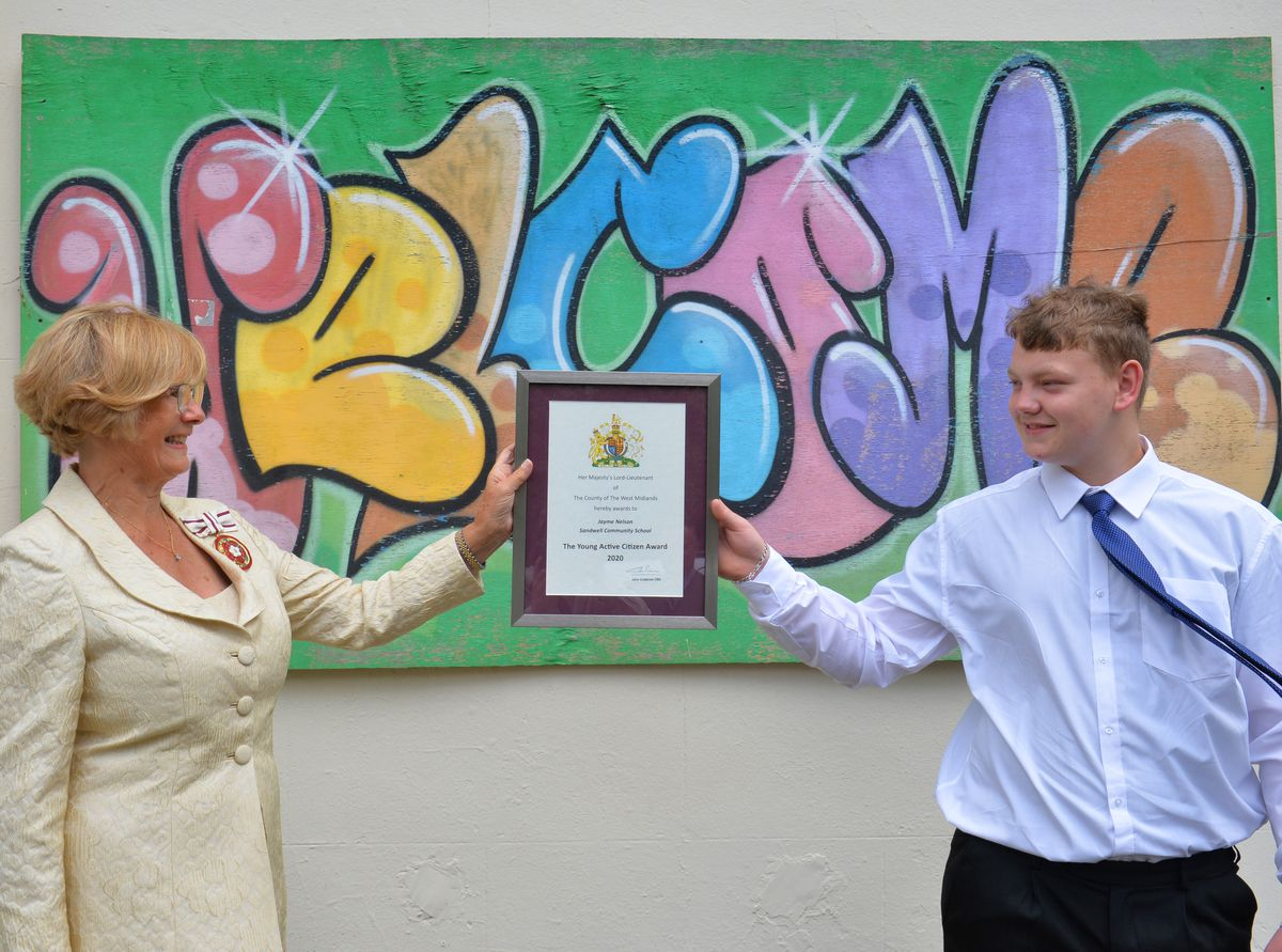Jayme Nelson receives the award from West Midlands Deputy Lieutenant Elizabeth Foster