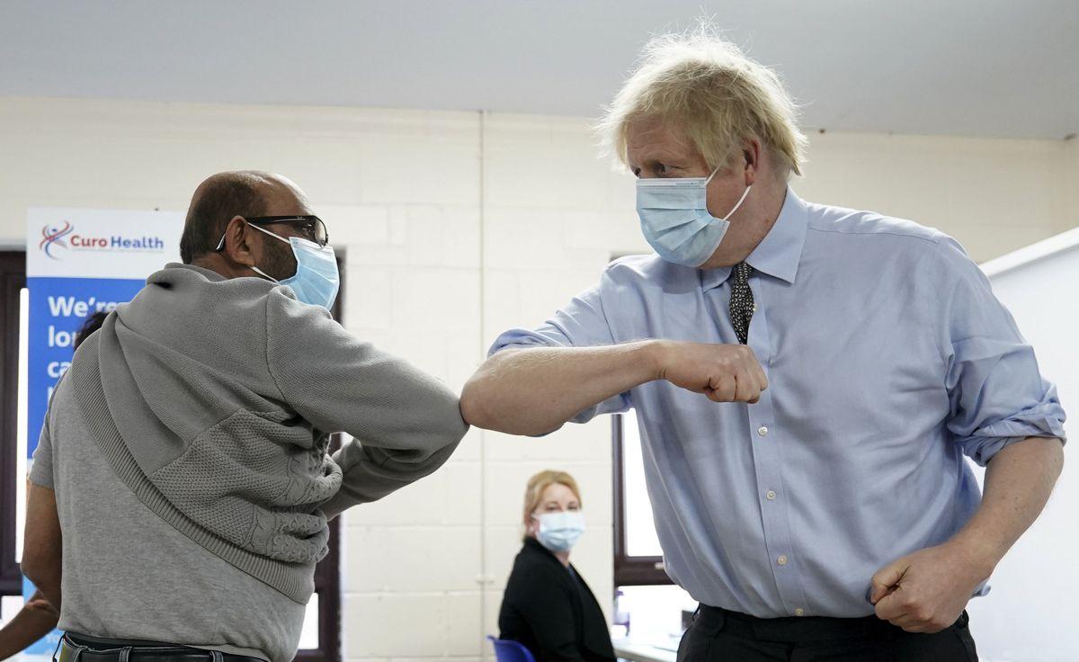 Prime Minister Boris Johnson elbow bumps Ismail Patel after getting his jab