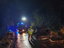 Driver escapes wreckage of car which flipped onto roof