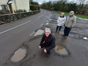 Councillor Len Winwood and residents Mary and Mike Swailes, who are worried about potholes in the road