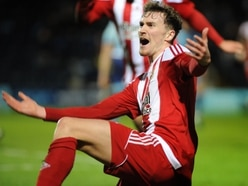 Ex-Stourbridge defender Dan Scarr stays on at Wycombe Wanderers