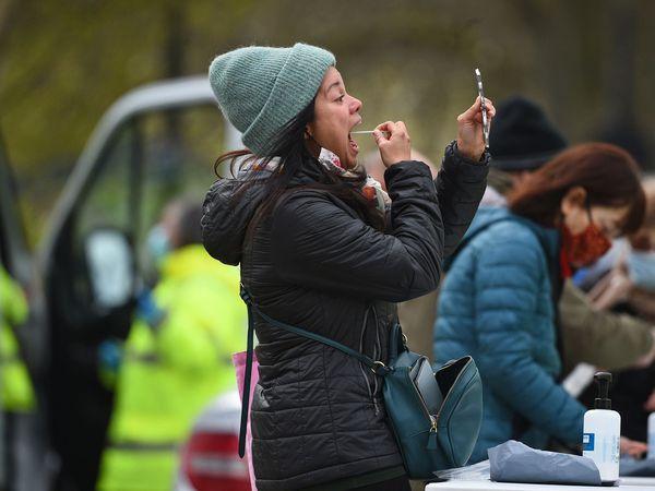 People take part in coronavirus surge testing