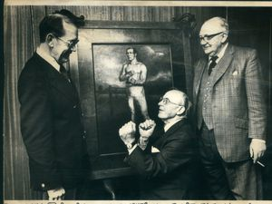 Tipton and Coseley Building Society chairman Edwin Holden squaring up to a portrait of William Perry, the Tipton Slasher, that the society had just bought in November, 1979, while general manager Stuart Eaton, left and director Tom Fisher look on