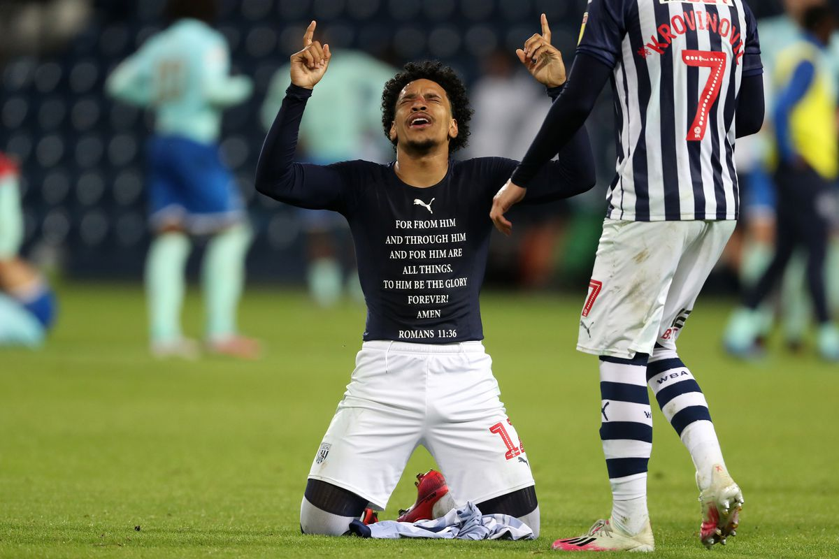 Matheus Pereira of West Bromwich Albion drops to his knees and points to the skies as he celebrates promotion to the Premier League on the pitch at the end of the match. (AMA)
