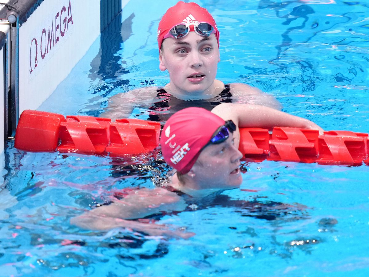 Great Britain's Tully Kearney, top, had to settle for 200m freestyle silver, while team-mate Suzanna Hext was fourth