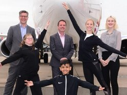 Ballet in full flight with airport
