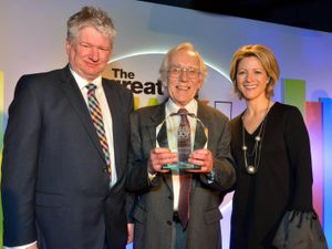 Sports commentator, Jacqui Oatley MBE, and Wolverhampton council's Keith Ireland presented him with the award