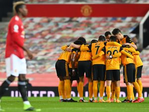 Wolverhampton Wanderers players huddle before the game.