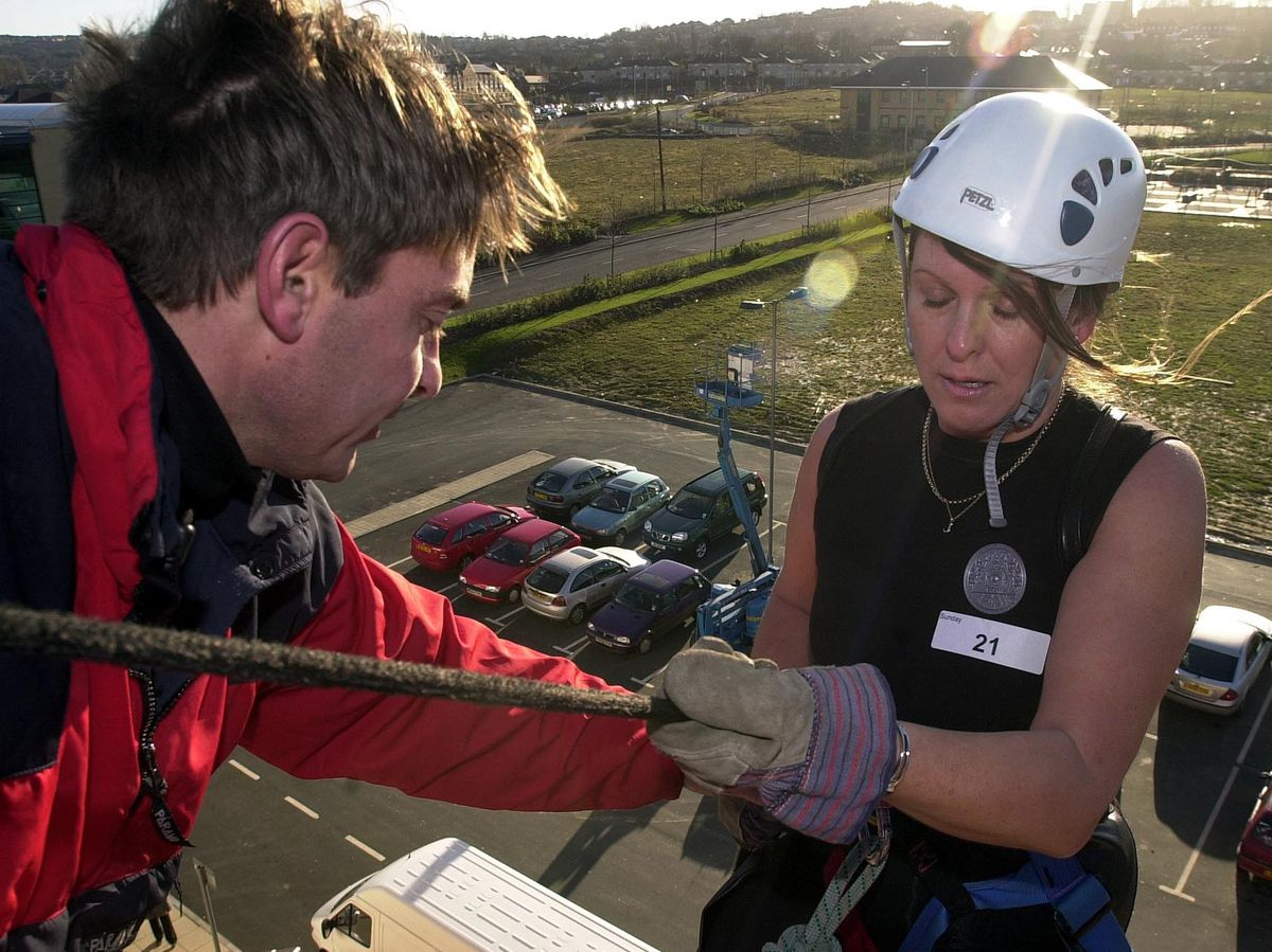 Janice Burns dressed as Lara Croft has last second jitters on the edge of the building
