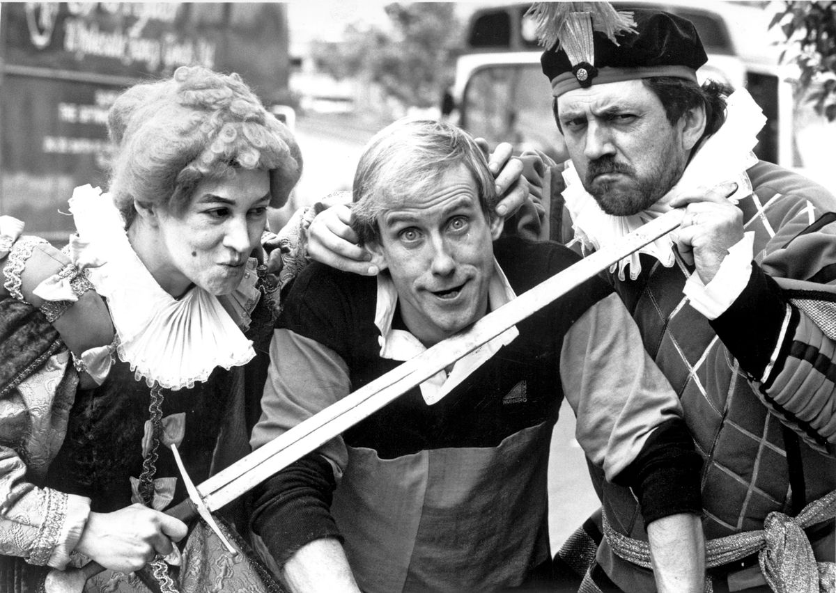 Comedian Dougie Parker (centre) is 'knighted' by Black Country 'Queen' Mary Ellen with the aid of Yeoman Bill