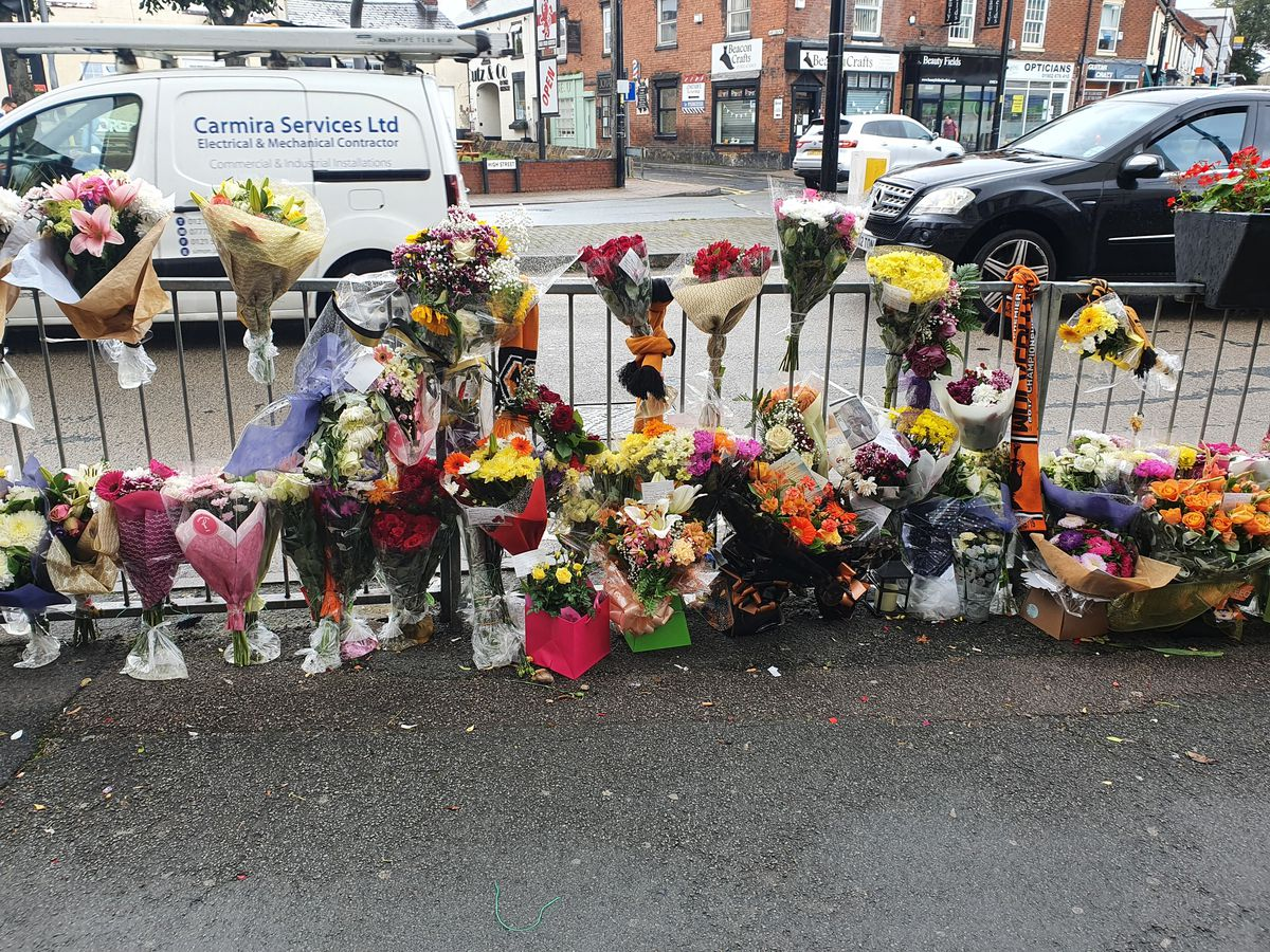 Some of the tributes left next to The Clifton pub