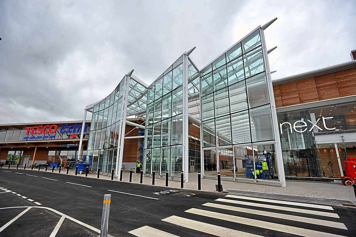 Exterior of New Square showing its Next and Tesco stores.