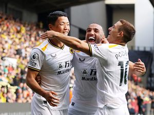 WATFORD, ENGLAND - SEPTEMBER 11: Hee-chan Hwang of Wolverhampton Wanderers celebrates after scoring his team's second goal with Marcal and Daniel Podence during the Premier League match between Watford and Wolverhampton Wanderers at Vicarage Road on September 11, 2021 in Watford, England. (Photo by Jack Thomas - WWFC/Wolves via Getty Images).