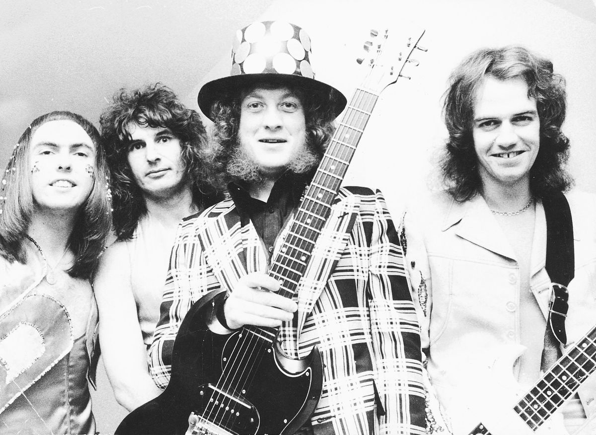 Dave Hill, left, and Don Powell, second from left, in Slade's heyday