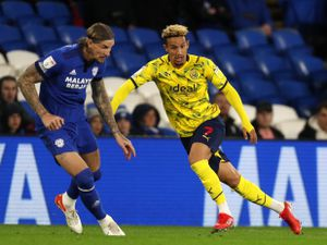 CARDIFF, WALES - SEPTEMBER 28: .Aden Flint Cardiff City  and Callum Robinson of West Bromwich Albion during the Sky Bet Championship match between Cardiff City and West Bromwich Albion at Cardiff City Stadium on September 28, 2021 in Cardiff, Wales. (Photo by Adam Fradgley - AMA/West Bromwich Albion FC via Getty Images).