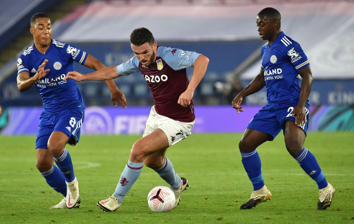 Aston Villa's John McGinn (centre) battles for the ball with Leicester City's Youri Tielemans